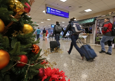 Keep germs at bay during holiday travels with the four tips. (Photo: George Frey/Getty Images)
