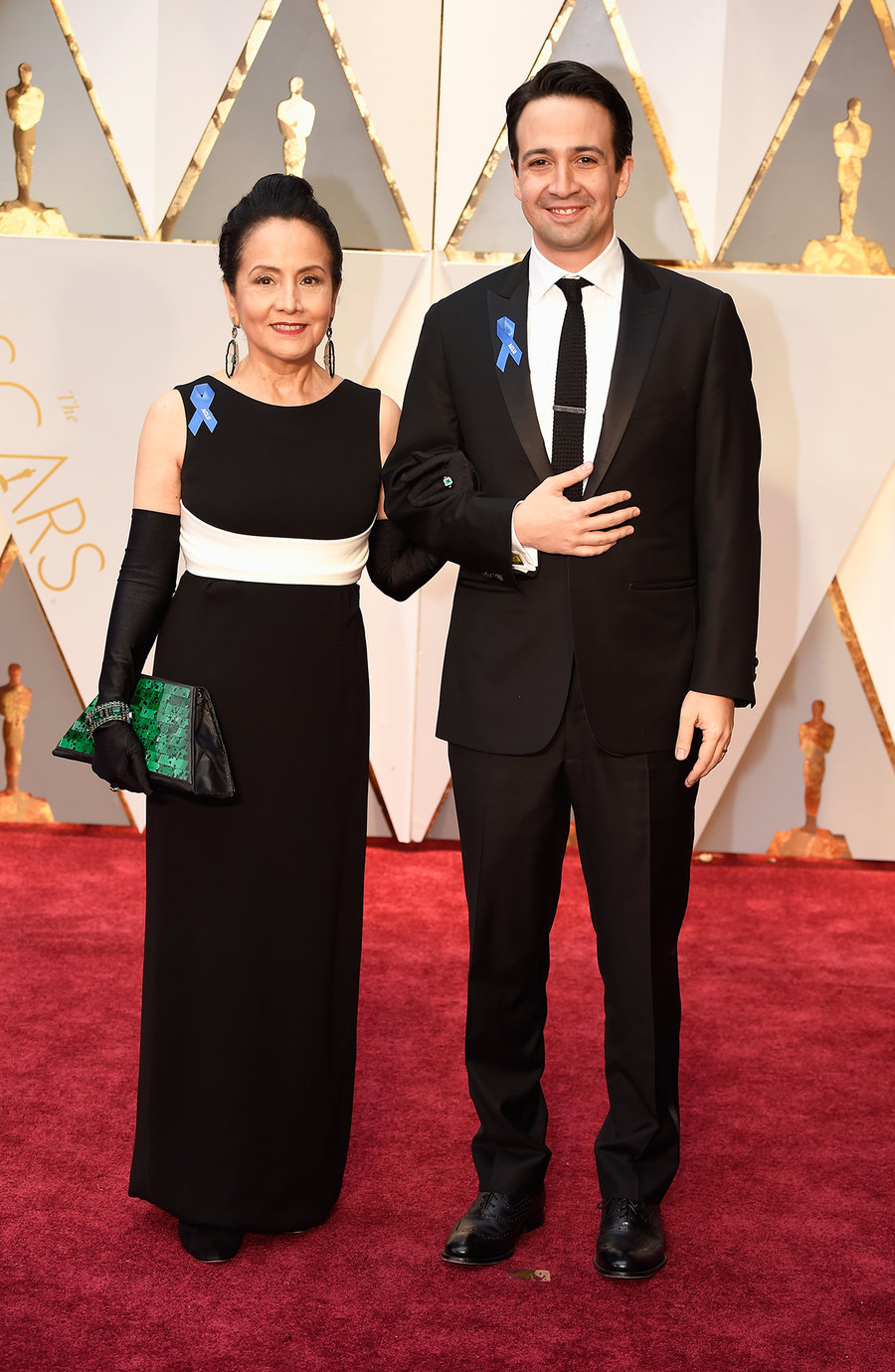 Lin-Manuel Miranda (right) and his mother, Luz Towns-Miranda, sport blue ACLU pins at Sunday's Oscars. (Photo: Getty Images)