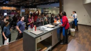 Chef Jerome Grant from the National Museum of African American History and Culture cooks up dishes that signify the culinary changes that came about due to the Great Migration of African Americans. (Photo: National Museum of American History)