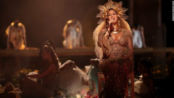 Beyonce, who is expecting twins, performed in a gold crown and matching embellished gown. (Photo: Christopher Polk/Getty Images)