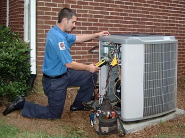 Repairman working on AC unit.