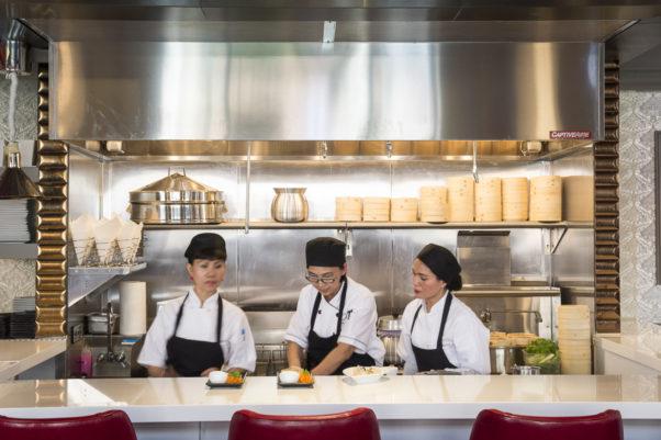 When Bangkok Joe's returned last April, it included a bigger dumpling bar. Pictured, center, is chef and owner Aulie Bunyarataphan. (Photo: Bangkok Joe's)