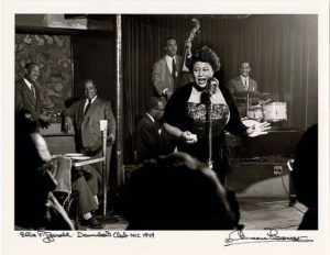 Ella Fitzgerald and her trio are pictured here performing at New York City's Club Downbeat about 1948. (Photo: Herman Leonard Collection)