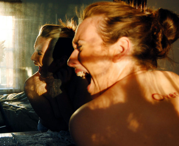 Photo of woman looking in mirror screaming. (Photo: jenavive/Flickr)