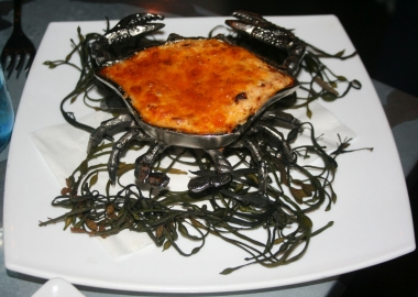 The flaming crab dip is served in a crab-shaped pan and flambeed tableside. (Photo: Mark Heckathorn/DC on Heels)