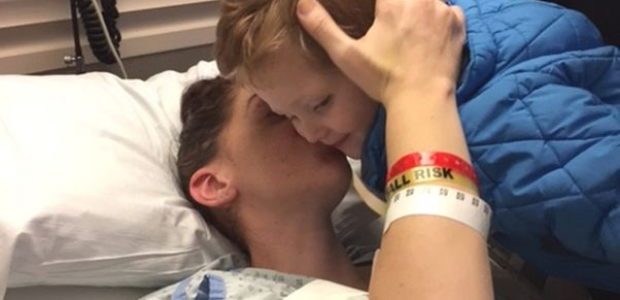 Lucy Alana Gnazzo kisses her son, Vincent, as he leans over her hospital bed. (Photo: Penn State)