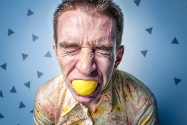 man sucing lemon (Source: BHRC)