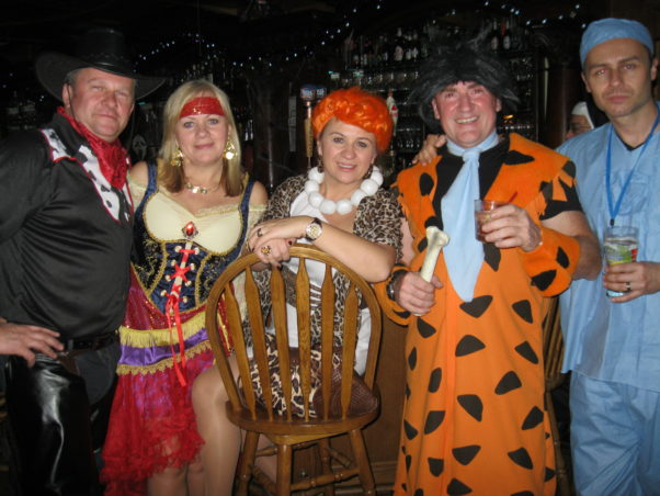 adults in costume at a Halloween Party