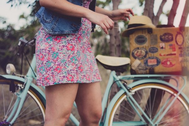 woman in flowered dress with bicycle (Photo: Pixabay)