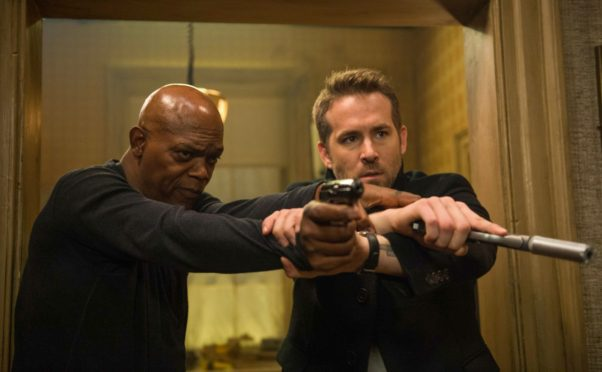 """The Hitman's Bodyguard"" with Samuel L Jackson and Ryan Reynolds finisehd first last weekend with $21.38 million. (Photo: Jack English/Lionsgate)"