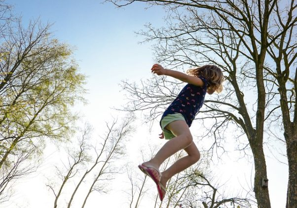young girl jumping on a trampoline. (Photo: Pixabay)