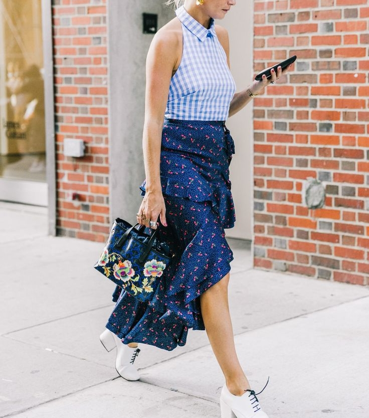 Pair a floral wrap skirt with a solid top to let the skirt shine. (Photo: Pinterest)