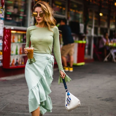 woman in mint green ruffled wrap skirt with long sleeve green top. (Photo: Jessica Wang)