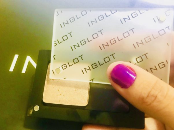 Inglot's Freedom Palette system uses magnets on the bottom of makeup containers so they fit into the palette, yet are interchangable. (Photo: Emma Blancovich/DC on Heels)