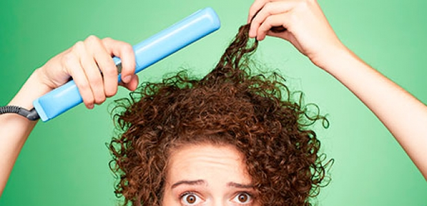 Tired to straightening your hair? Try these conditioners to tame your curly locks. (Photo: Matthew Reier)