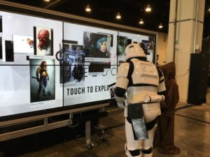 A storm tropper and an ewok check out a touch screen at the 2016 Escape Velocity conference. (Photo: F2B Serives)