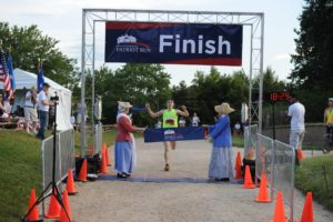 A runner crosses the finish line at the George Washington Patriot Run at Mount Vernon. (Photo: George Washington's Mount Vernon)