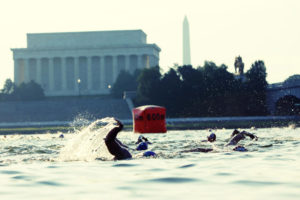 Participants in the Nation's Triathlon swim in the Potomac River past the Lincoln Memorial. (Photo: Nation's Triathlon)