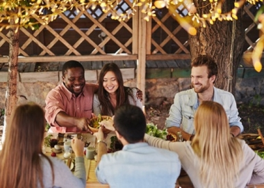 Surround yourself with good company and plenty of food. (Photo: Shutterstock)