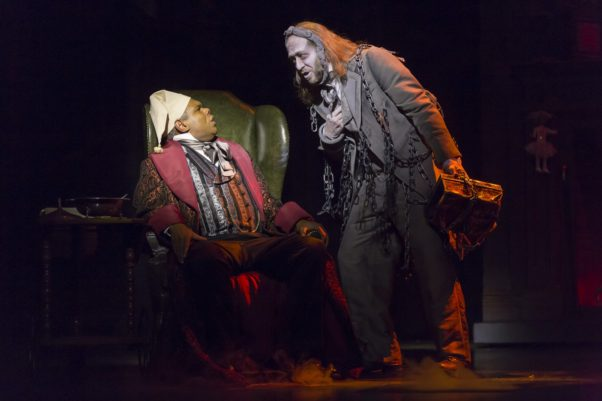Ebenezer Scrooge is visited by one of the Christmas ghoasts in A Christmas Carol at Ford's Theatre. (Photo: Scott Suchman)