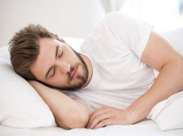 man sleeping on side (Photo: Shutterstock)