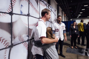 Max Scherzer (left) hugs a young fan at Nationals Winterfest. (Photo: Washington Nationals)