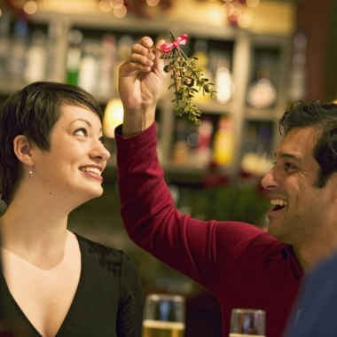 Even if there is mistletoe, it is best to keep thing professional and not kiss it at your office holiday party. (Photo: Getty Images)