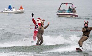 Santa and two raindeer on skis. (Photo: AFP)