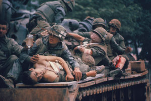 John Olson's photograph of injured Marines being evacuated on a tank is one of the most iconic images from the Vietnam War. (Photo: John Olson)