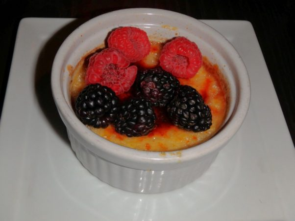 Try the caramel crème brule with fresh berries for dessert. (Photo: Nick Bullock/DC on Heels)