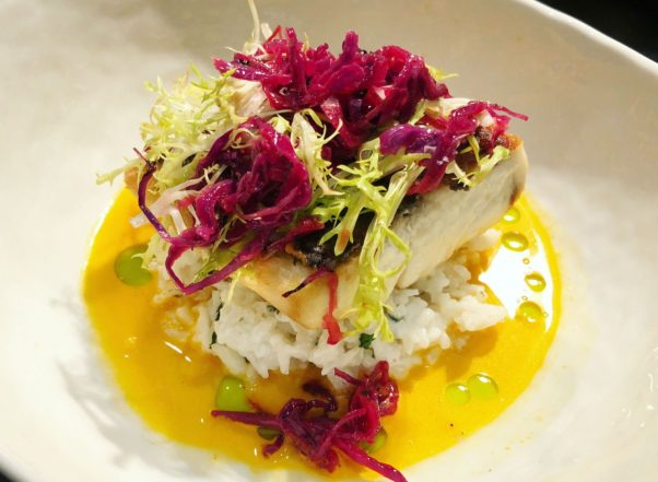 Pan-seared redfish with aji seafood nage atop coconut lime rice and grilled red cabbage is on The Royal's new winter menu. (Photo: The Royal)