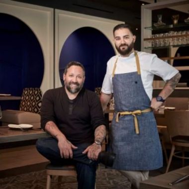 Mike Isabella (seated) and chef Michael Rifidi at Arroz (Photo: Arroz)