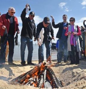 Visitors throw socks in a bonfire at the Annapolis Maritime Museum's oyster and sock burning. (Photo: Annapolis Maritime Museum)
