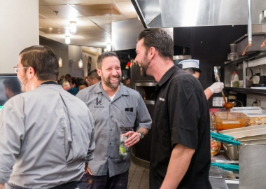 Mike Isabella (center) and George Pagonis (right) at Graffiato's five year anniversary celebration. (Photo: Rey Lopez)