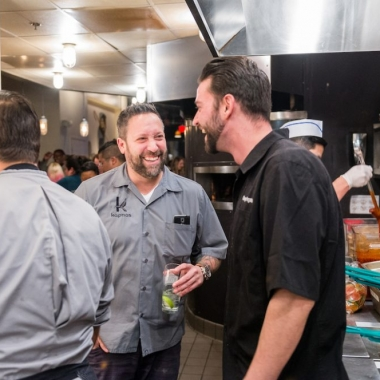 Mike Isabella (center) and partner George Pagonis (right) in the kitchen at Graffiato's five year anniversary celebration. (Photo: Rey Lopez)