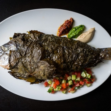 Sababa will feature modern Isreali cuisine including a daily whole roasted fish wrapped in grape leaved. (Photo: Scott Suchman)