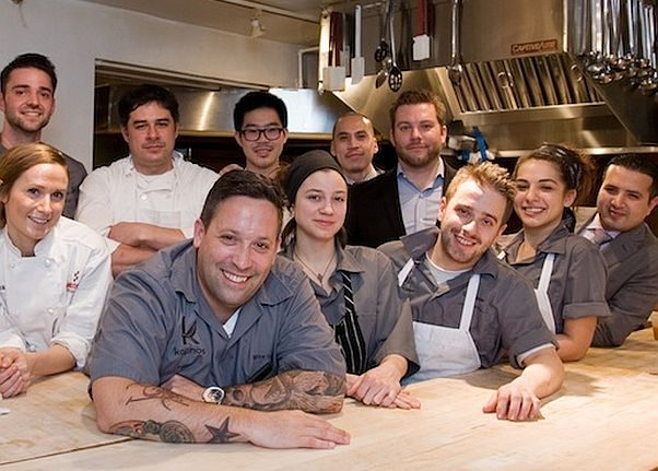 Chef Mike Isabella (front) and team, including partners George Pagonis (far left, back), Nick Pagonis (black suit jacket on right) and Taja Ismail (far right) at a dinner at the James Beard House in 2013. (Photo: James Beard Foundation)