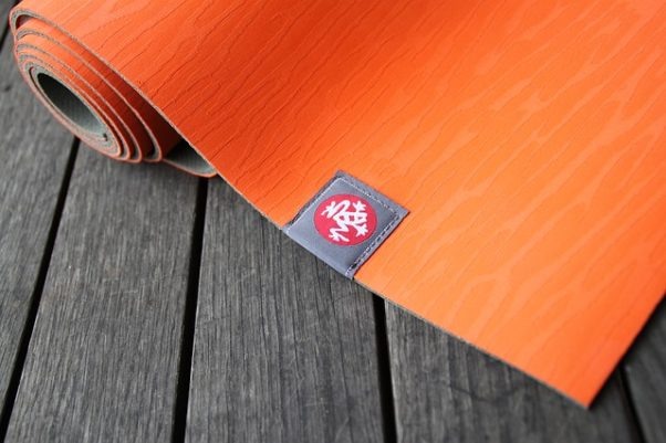 partially unrolled orange yoga mat (Photo: Jenma/Pixabay)