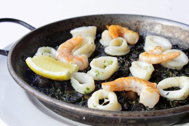 Taberna del Alabardero's new Sunday brunch includes arroz negro, black squid ink rice with calamari and shrimp. (Photo: Taberna del Alabardero)