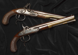 See the pistols used by Alexander Hamilton and Aaron Burr, which killed Hamilton. (Photo: National Postal Museum)