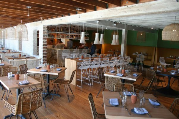 Buena Vida's main dining room includes low tables, booths and a communal table. (Photo: Mark Heckathorn/DC on Heels)