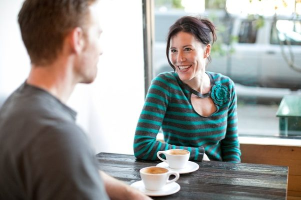 Man and woman havin-g coffee. (Photo: RachelScottYoga/Pixabamay)
