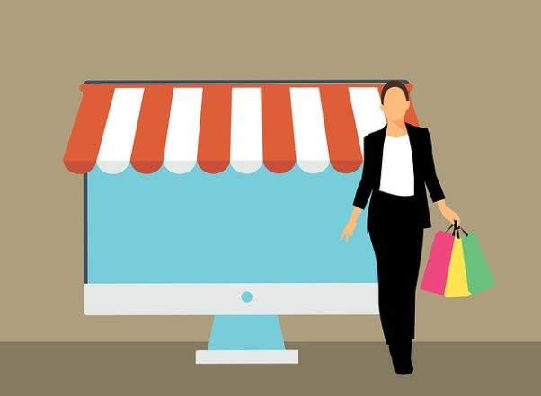 Illustration of a woman with shopping bags in front of a computer screen with an awning over it. (Illustration: Mohamed Hassan/Pixabay)