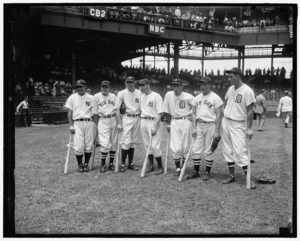The 1937 All-Stars include (l to r) Lou Gehrig (Yankees), Joe Cronin (Red Sox), Bill Dickey (Yankees), Joe DiMaggio (Yankees), Charlie Gehringer (Tigers), Jimmie Foxx (Red Sox) and Hank Greenberg (Tigers) at Griffith Stadium in Washington, DC. (Photo: Harris & Ewing)