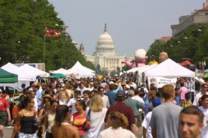 Crowds walking along Pennsylvania Avenue between vendors with the U.S. Capitol inthe background (Photo; National Capital Barbecue Battle)
