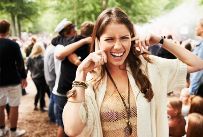 If you are going to a concert this summer, stand as far away from the speakers as possible to prevent hearling loss. (Photo: Getty Images)