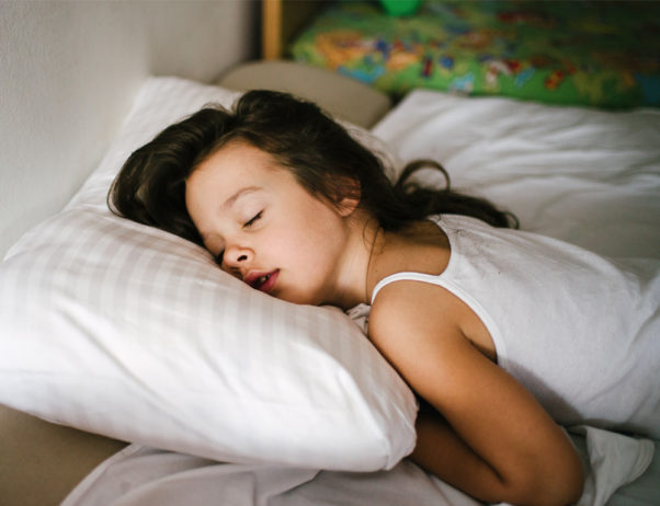 With summer in and school out, lack of sleep can cause irritability, headaches and difficulty paying attention in children. (Photo: Getty Images)