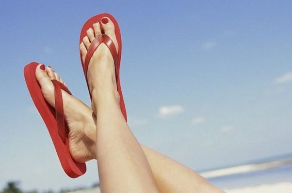 Despite their popularity, flat sandals or flip-flops dont provide enough support for your feet and wearing them for extended periods of walking or physical activity can lead to ankle sprains or plantar fasciitis. (Photo: Getty Images)