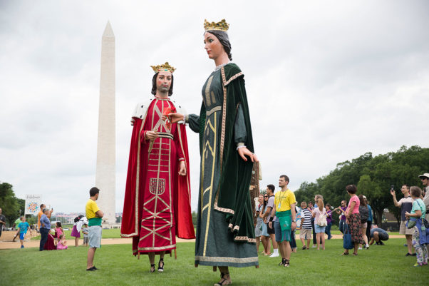 The gegants (giants) from Catalonia lead a process across the National Mall. Created in 1977 by the Casa Ingenio studio, these giants represent a queen and a king named after Oliana's patron saints, St. Andrew and the Virgin of Angels (Photo: Daniel Martinez Gonzales/Ralph Rinzler Folklife Archives)