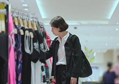 Woman shopping for clothes. (Photo: iStock)